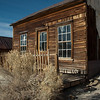 Bodie, California October 27, 2012 : Bodie is a ghost town in the Bodie Hills east of the Sierra Nevada mountain range in Mono County, about 75 miles southeast of Lake Tahoe. It is located 12 miles ESE of Bridgeport, at an elevation of 8,379 feet. In 1859 William (a.k.a. Waterman) S. Bodey discovered gold near what is now called Bodie Bluff. A mill was established in 1861 and the town began to grow. It started with about 20 miners and grew to an estimated 10,000 people by 1880. By then, the town of Bodie bustled with families, robbers, miners, store owners, gunfighters, prostitutes, and people from every country in the world. Among the reported 65 saloons in Bodie were numerous brothels, gambling halls, and opium dens. Approximately 5% of Bodie's buildings survive in today's California State Historical Park. http://en.wikipedia.org/wiki/Bodie_California http://bodie.com